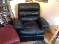 Black leather reviling arnchair
