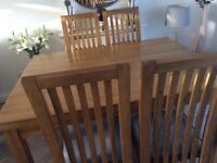 Oak dining table and four chairs upholstered in Grey