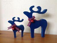 Christmas reindeer decorations pair blue star gazing red blue tartan ribbons