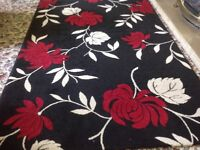 Rug. Red, black and cream. Excellent condition. Appro 230 x 180