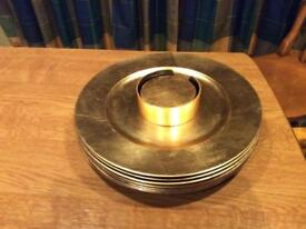 Ten 33cm. Gold charger plates and matching 6 piece coaster set.