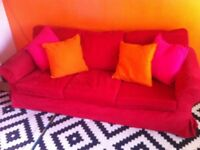 Red Ikea cord Ektorp three seat sofa