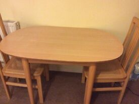 Dining table and two chairs for sale