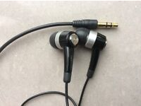 Pair of new unused Samsung in ear headphones earphones