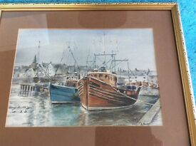 Two harbour scenes with fishing boats prints by A HIrst, in gold frames