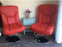 2 red swivel chairs