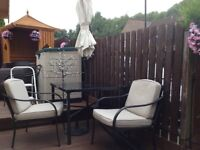 garden table and four chairs with parasol