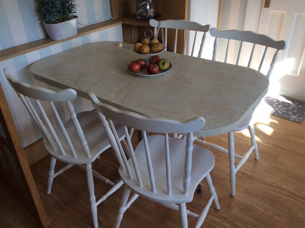 kitchen table with four good quality white chairs  in