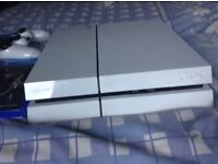 White PlayStation 4 (includes wires and games and controller)