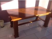 Extendable solid wood dining table