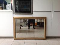 Gold framed mirror with bevelled edge glass