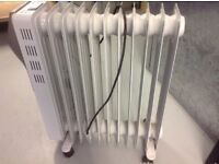 Electric oil filled radiator with timer and temperature controls.