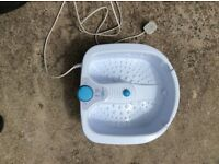 Electric foot spa/heats up water and vibrates to soothe sore feet.