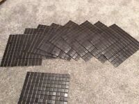 Matt black small tiles in sheets