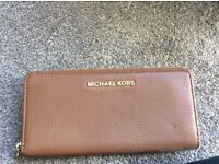 Tan colour Michael Kors purse. Immaculate condition been used once.