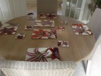 Set of 6 matching wipe able table mats and coasters in very good condition.