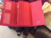 Louis Vuitton multicolour purse.