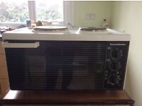 Small table top cooker with oven , grill and two hotplates