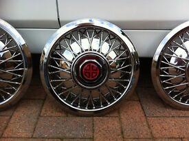 Beautiful chrome spoke wheel trims .