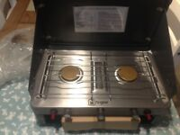 For sale a brand new 2 burner /grill portable cooker.