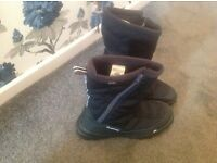 Boots for walking in ski resort, size 10.5 as new, worn once as too small.