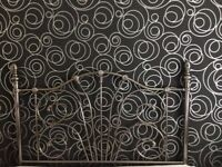 Ornate metal headboard