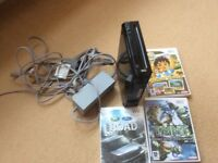 Wii console and cables and three games