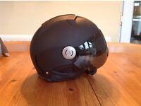 Black Dainese ski helmet with visor