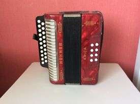 Hohner Erica button accordion.