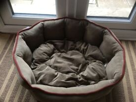 Soft brown swede style raised sided dog bed.