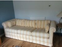 3 seater sofa in good condition. Craftsmen built with oak frame. Feather back cushions.