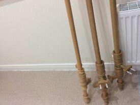 Pair of Wooden curtain poles, oak.