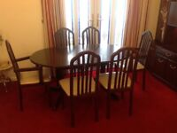 Regency style mahogany dining table and 6 chairs