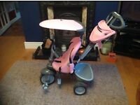 Pink 4 in 1 smart trike for children from 10-36 months with sunshade