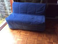 Ikea sofa bed in blue cover.