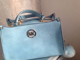 MK style handbag small mark on front refecting on price lovey bag pale blue