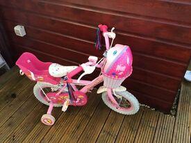 "Girls pink cupcake bike 12"" wheels complete with dolly Carrier, basket and peppa pig helmet"