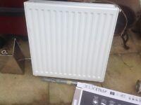 Small white radiator. Good condition