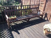 Large hard wooden benches