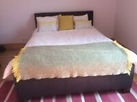 King size leather bed with 2 storage draws. Great condition.