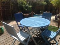 Circular Patio Table and four chairs in excellent condition