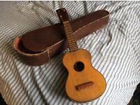 Old / vintage ukelele with custom case