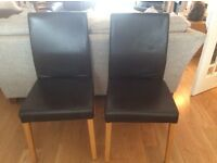 Pair of Habitat brown genuine leather dining chairs with solid oak legs