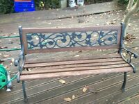 Garden bench with cast ends and back inset