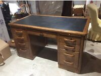 Hardwood desk with leather surface