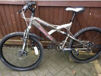 Barracuda mountain bike in excellent condition full suspension alloy frame.