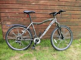 "Raleigh Trail bicycle 21 speed, 20"" frame, 23"" wheel."