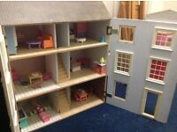 Large dolls house with furnitures.