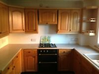 Kitchen Solid Oak with cabinets. Good condition. Spare new boxed doors.
