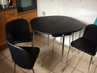 Black kitchen table and chair set from Argos excellent condition